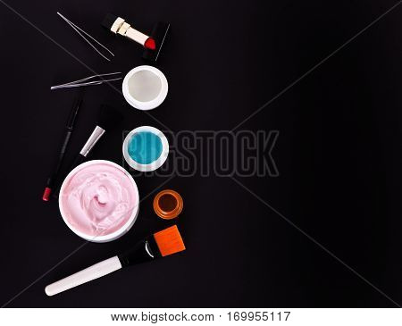 Various Cosmetics: Cream, Gel, Lipstick, Lip Liner, Brushes And Tweezers