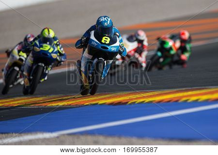 VALENCIA, SPAIN - NOV 11: 8 Bulega, 31 Fernandez during Moto3 practice in Motogp Grand Prix of the Comunidad Valencia on November 11, 2016 in Valencia, Spain.
