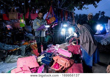 Delhi, India - 28th Jan 2017: Street market in Chandni Chowk near red fort at night. Open shops perfect for low budget items.