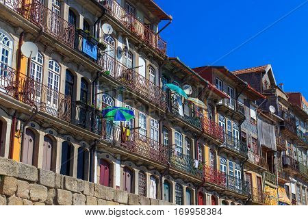 September 19, 2012: One of the most touristic spots by the old riverside streets. Where one can admire the European Style Buildings facing the Douro River in Porto, Portugal