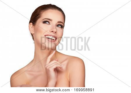Beautiful Young Woman with Clean Fresh Skin close up isolated on white. Beauty Girl Portrait. Spa Woman Smiling and touching her skin. Perfect Fresh Skin.