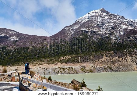 SAN CARLOS DE BARILOCHE RIO NEGRO ARGENTINA - SEPTEMBER 11 2015: Some tourists in front of a huge mountain in the tour of the Black Snowdrift in San Carlos de Bariloche.