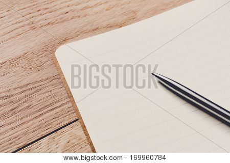 Notepad and personal diary or organizer closeup, writer's paperwork concept. Office or student's device on wooden desk. Working table top view. Education background with copy space on paper