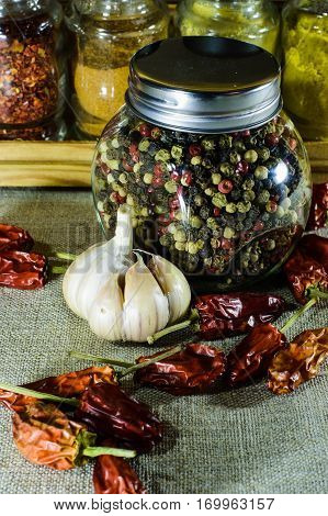 The Jar Of Whole Pepper And Pepper Chili And Garlic.