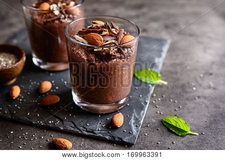 Nutritious chocolate chia seeds pudding in a glass jar