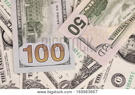 SARANSK, RUSSIA - FEBRUARY 5, 2017: Closeup shot of United States one hundred-dollar and fifty-dollar bills.
