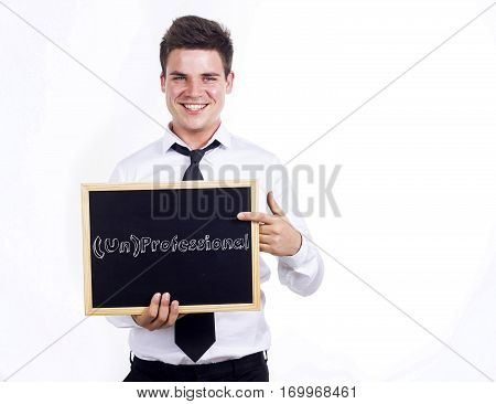 (un)professional - Young Smiling Businessman Holding Chalkboard With Text