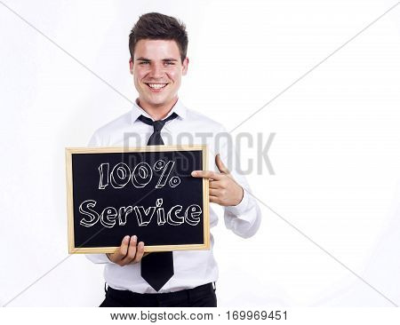 100% Service - Young Smiling Businessman Holding Chalkboard With Text