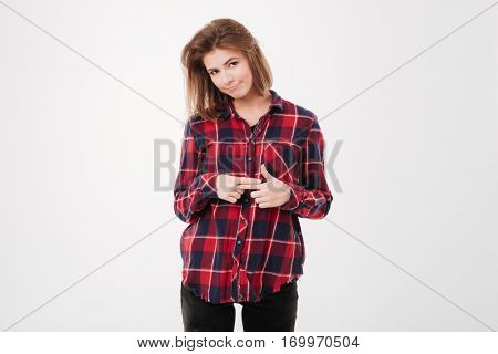 Portrait of beautiful young shy girl in plaid shirt looking at camera isolated on a white background