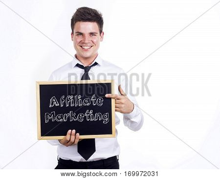 Affiliate Marketing - Young Smiling Businessman Holding Chalkboard With Text
