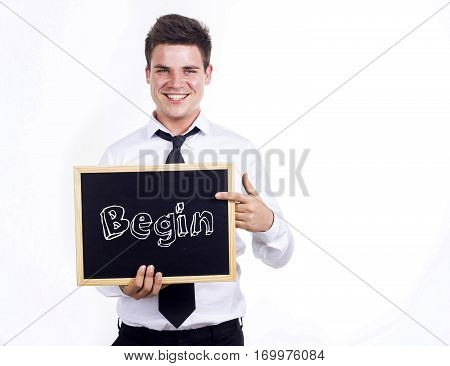Begin - Young Smiling Businessman Holding Chalkboard With Text