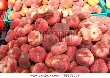 A pile of fresh peaches in a market