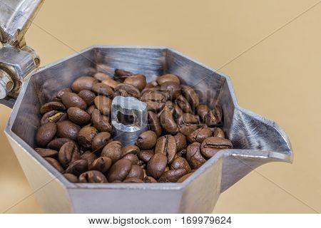 a coffee maker with coffee beans inside