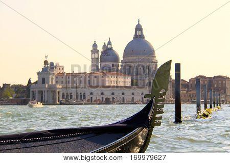 Gondola on Grande Canal with historic Basilica de Santa Maria della Salute