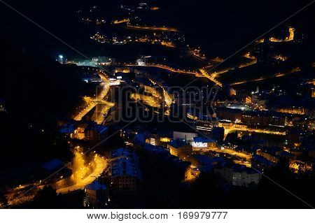 Night bird's-eye view on mountain inhabited locality in Andorra