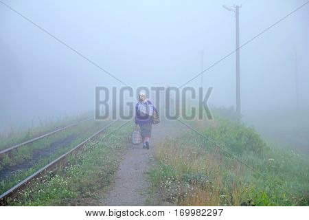 scene of an old woman - the female bogey in the mist