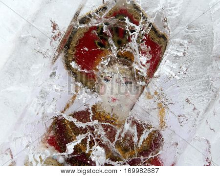 Russian doll in ice block winter background