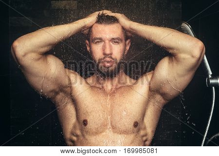 Fitness Man Taking A Shower And Holding Hands In Head. Close Up Shower And Bath Details