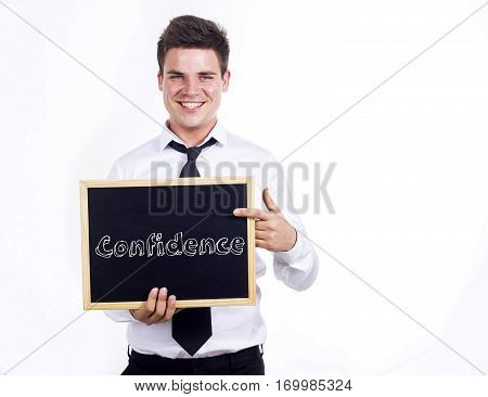 Confidence - Young Smiling Businessman Holding Chalkboard With Text