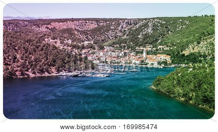 Town Of Skradin On Krka River In Dalmatia, Croatia Viewed From Distance. Vintage Post Processing.