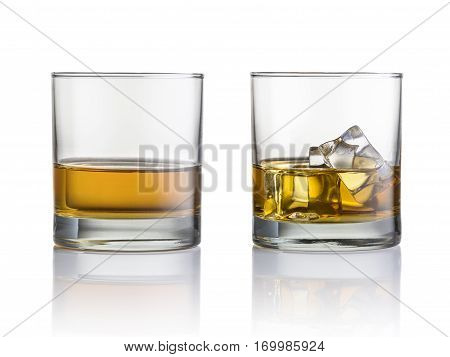 Glasses of whiskey and ice isolated on a white background