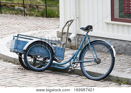 Cargo version of the bicycle with a large front garden trolley