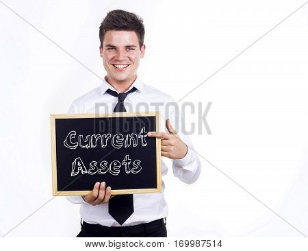 Current Assets - Young Smiling Businessman Holding Chalkboard With Text