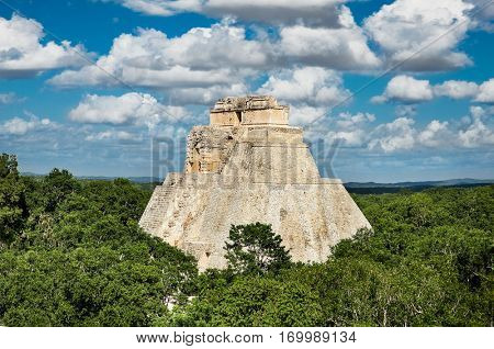 Mayan pyramid of the Magician (Piramide del adivino)in the middle of the jungle, Uxmal, Mexico