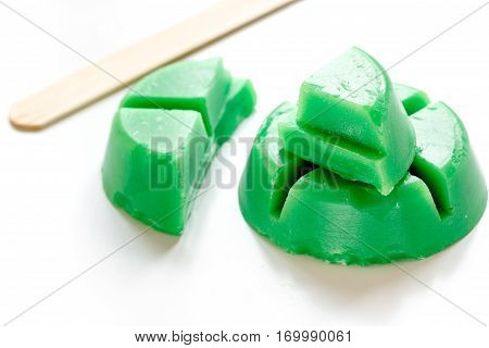 wax for depilation on white background close up