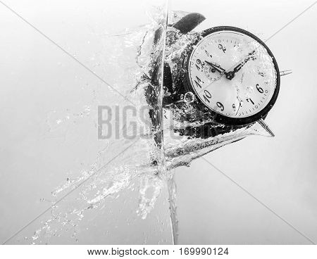 Drowning clock in the water representing stress.