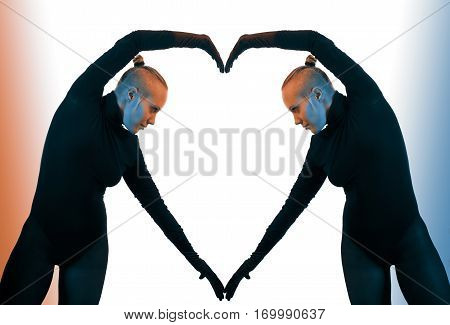 Creative concept heart symbol of love fromed by two female bodies mirroring each other horizontal view against colorful background