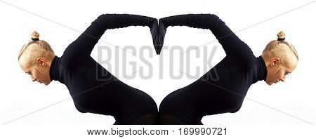 Creative concept heart symbol of love fromed by two female bodies mirroring each other horizontal view isolated on white background