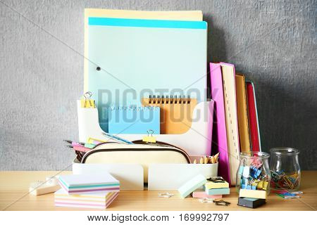 Colorful stationery on wooden table
