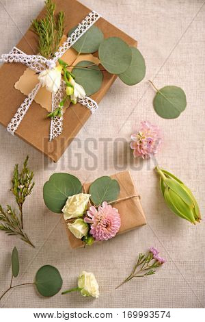 Handcrafted gift boxes with flowers on table