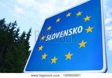 Staged photo with Slovak border sign on the road.