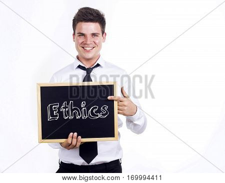 Ethics - Young Smiling Businessman Holding Chalkboard With Text