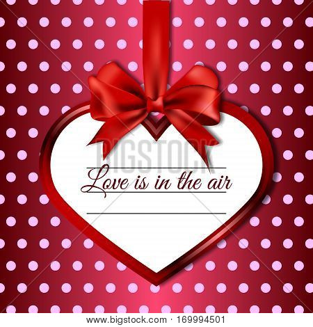 Vector illustration of hanging on satin ribbon bow heart with the words love in the air, on a background polka dot