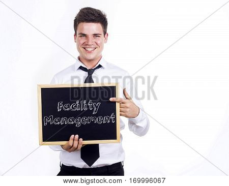 Facility Management - Young Smiling Businessman Holding Chalkboard With Text