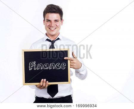 Finance - Young Smiling Businessman Holding Chalkboard With Text