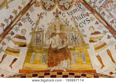 Erik Plovpenning on his throne, Romanesque fresco in St. Bendt church, Ringsted, Denmark - February 20 2015