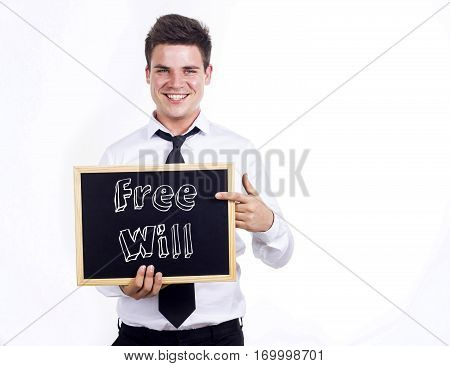 Free Will - Young Smiling Businessman Holding Chalkboard With Text