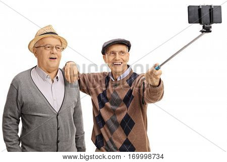 Cheerful seniors taking a selfie with a selfie stick isolated on white background