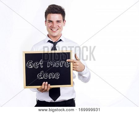 Get More Done - Young Smiling Businessman Holding Chalkboard With Text