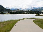 Walkway along Lake Estes waterfront city of Estes Park, Colorado poster