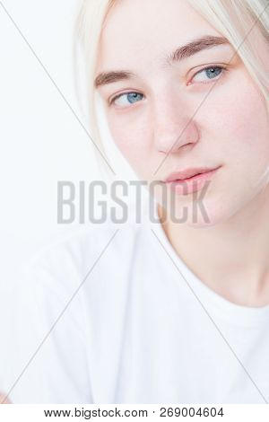 Thoughtful Wistful Pensive Woman Portrait On White Background.