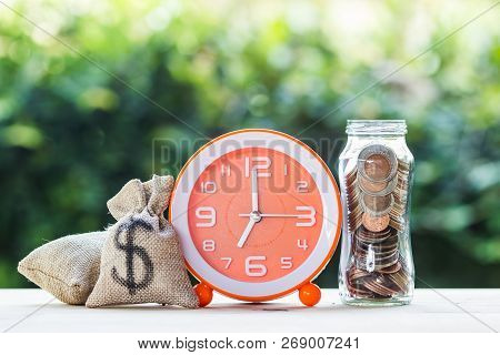 Money Savings, Investment, Time And Money Growing Concept : Stacking Growing Coins, Moneybags And Or