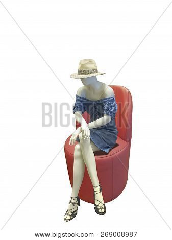 Female Mannequin Sitting On A Round Red Leather Chair Over White Background. No Brand Names Or Copyr
