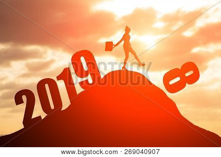 Silhouette Of Businesswoman On The Moutain With 2019