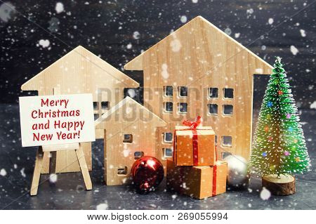 Christmas Tree, Wooden Houses And Gifts With The Inscription
