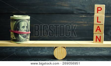 Dollars And Word Plan Are On The Scales. Financial And Budget Planning. Financial Investments And Go